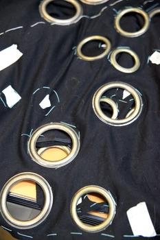 Large grommets applied to fabric.